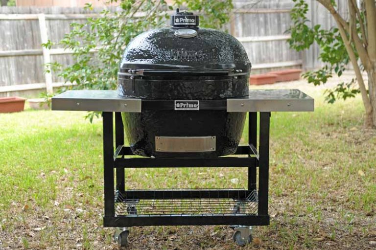 The Primo XL 400 Ceramic Kamado Grill and Smoker in a backyard setting.