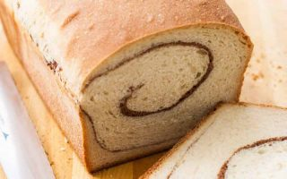 Horizontal close-up image of a loaf with a swirl.