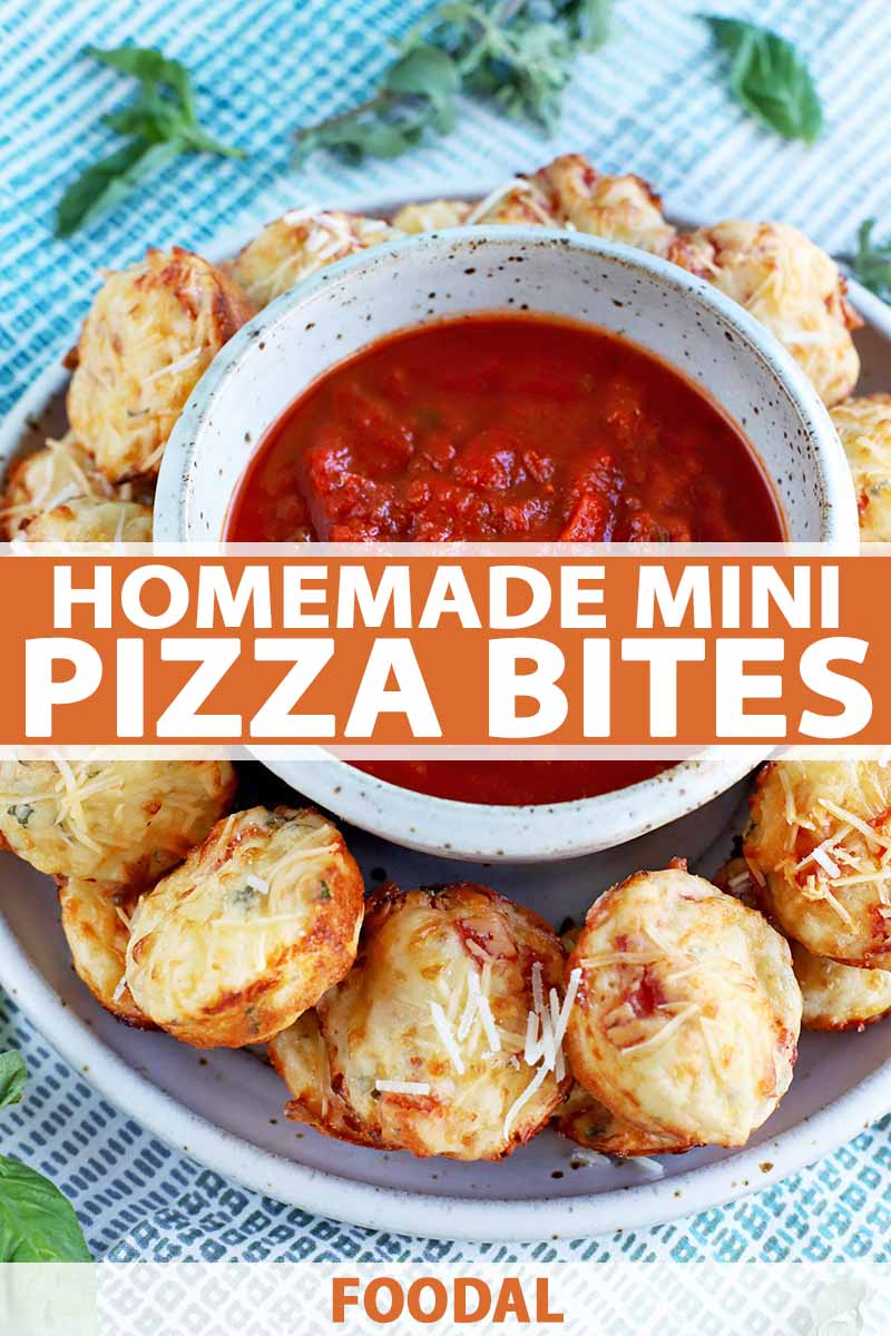 Vertical image of savory pizza-flavored muffins arranged in a ring on a plate with a small bowl of marinara sauce at the center, on a blue and white checkered fabric background with scattered sprigs of basil, printed with orange and white text.