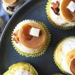 Horizontal image of pancake cupcakes on a dark plate.