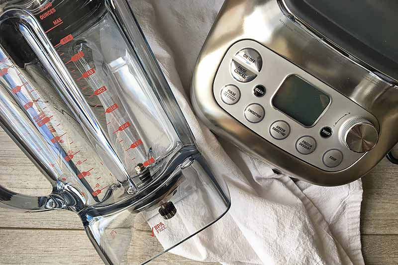 Horizontal image the Breville Super Q blender base and the clear jug on a white towel.