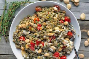 Warm French Lentil Salad with Tomatoes, Marcona Almonds, and Goat Cheese