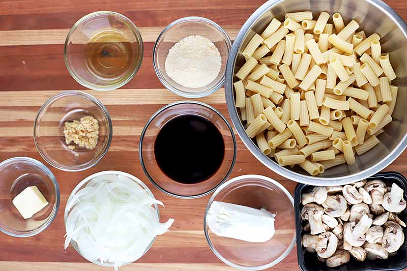 Horizontal image of ingredients to make a balsamic, mushroom, and goat cheese pasta dish.