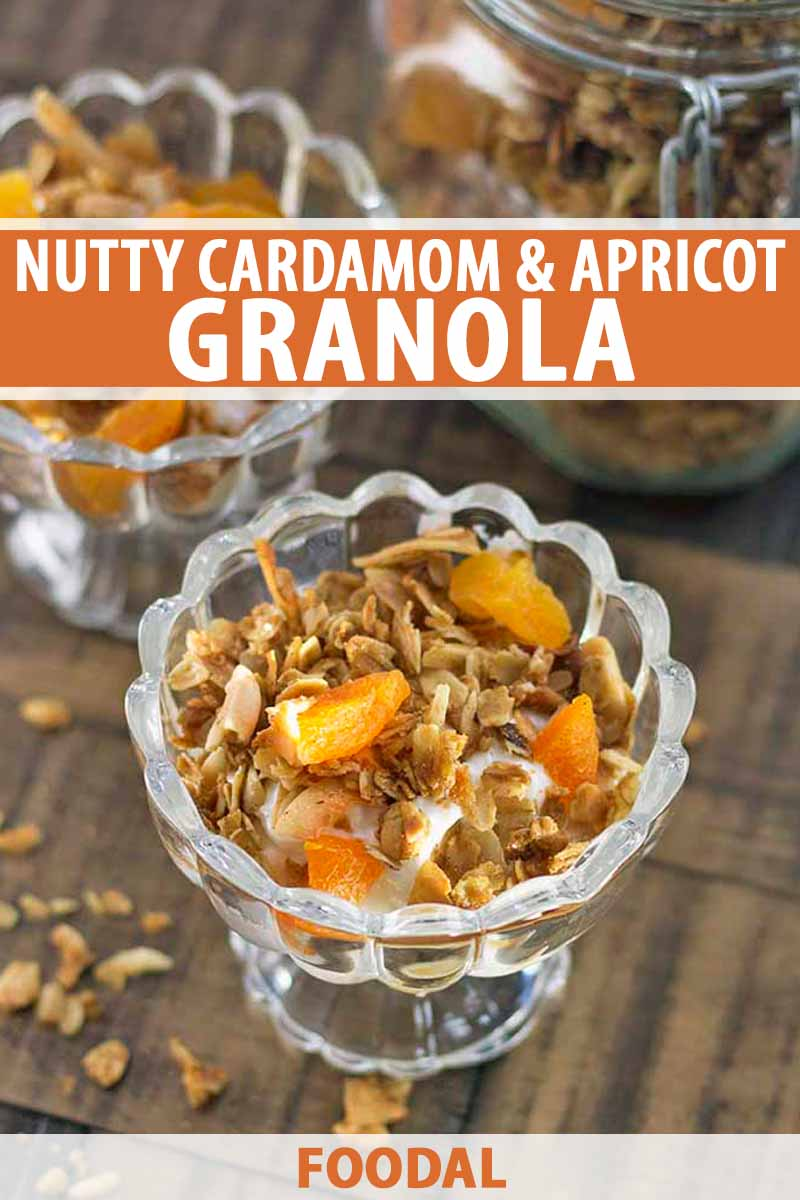 Vertical image of two parfait glasses of yogurt topped with apricot and nut granola, with a swingtop glass jar of the cereal in the background, on a brown wood surface with scattered oats, printed with orange and white text at the midpoint and the bottom of the frame.