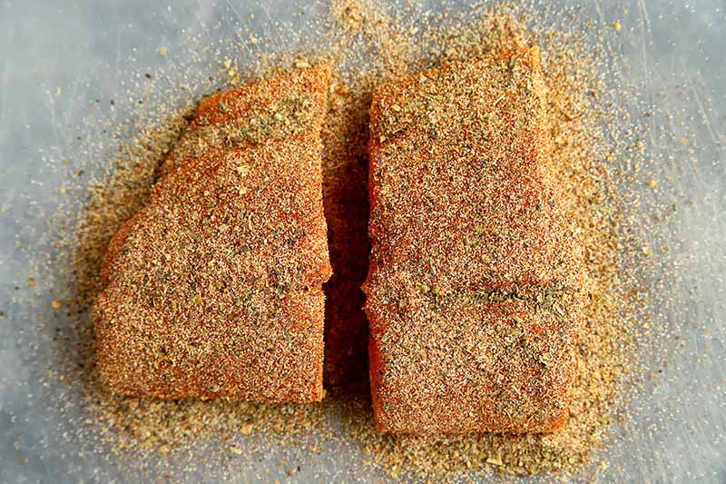 Horizontal image of seasoned uncooked fish fillets