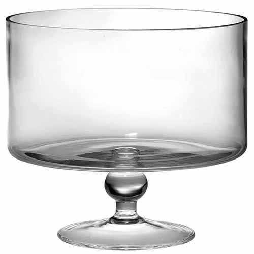 Clear glass trifle serving bowl, isolated on a white background.