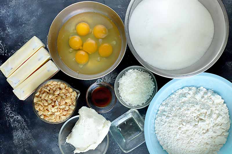 Horizontal image of ingredients to make a coconut macadamia nut cake.