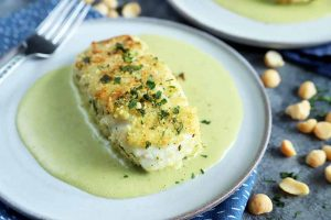 Elegant Macadamia Nut Crusted Halibut with Fresh Herbs and Coconut Sauce