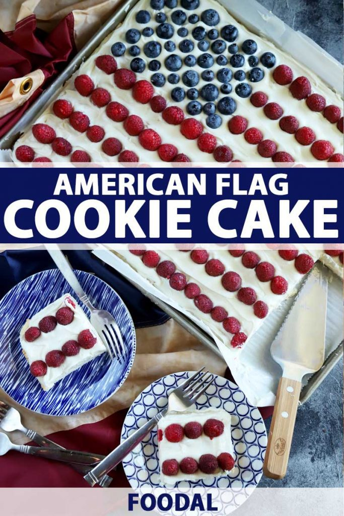 Top view of an American flag cookie cake made with raspberries and blueberries. The bulk of the cake is still intact in its sheet pan with two pieces on blue ceramic plates.