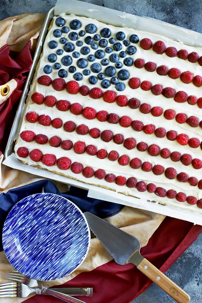 Top down view of the American flag cookie cake focused on the blue and white start section made with blueberries.