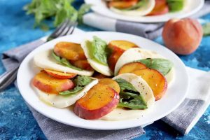 Lighten Up Your Summer Dinner with a Fresh Peach Caprese Salad