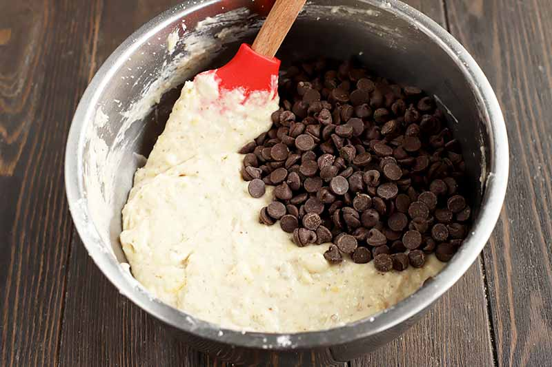 Horizontal image of a batter with a pile of chocolate chips.