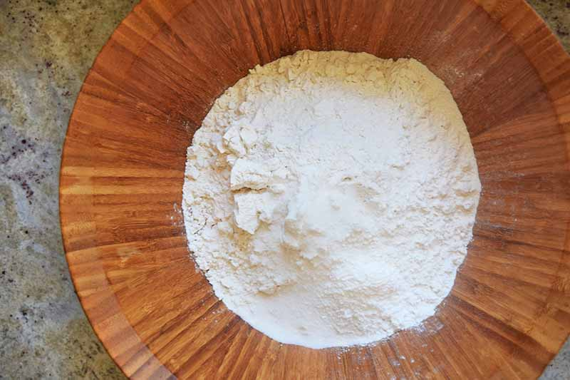 Horizontal image of a brown bowl with dry ingredients.