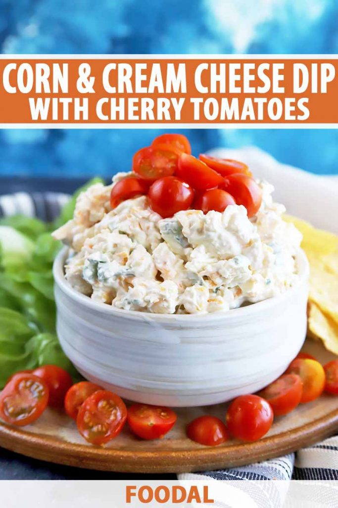 Vertical image of a white bowl with a light yellow creamy appetizer topped with sliced cherry tomatoes, with text on the top and bottom of the image.