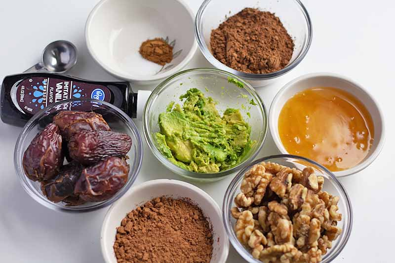 Horizontal image of assorted ingredients to make raw brownies.