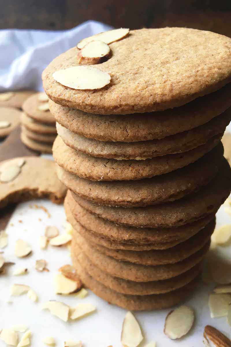 Vertical image of a teetering stack of almond wafers.