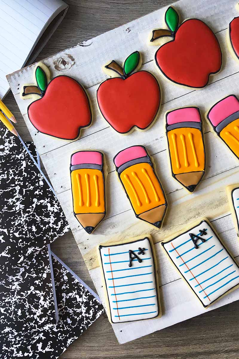 Vertical image of rows of school-themed cookies.