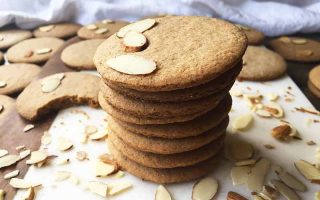 Horizontal image of a small stack of nut cookies.