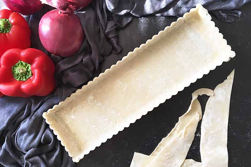 Horizontal image of a prepped pan with pie dough.