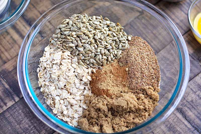 Horizontal image of a glass bowl with portioned areas of dry ingredients.