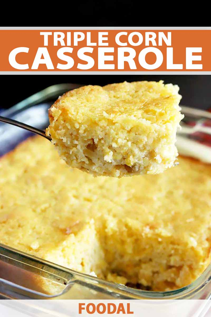 Vertical closeup image of a square portion of corn casserole being lifted from a glass baking dish filled with the rest by a large serving spoon, printed with orange and white text near the top of the frame and at the bottom, on a black background.