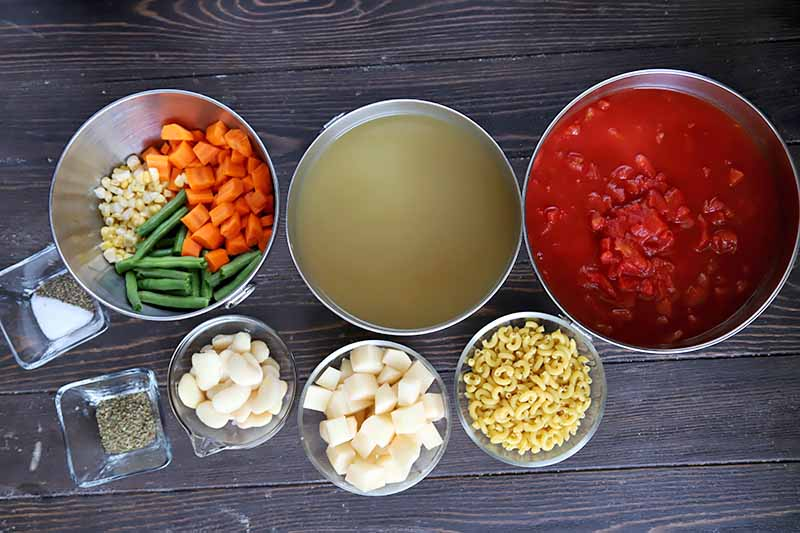 Horizontal image of vegetables, broth, and tomato sauce in bowls.