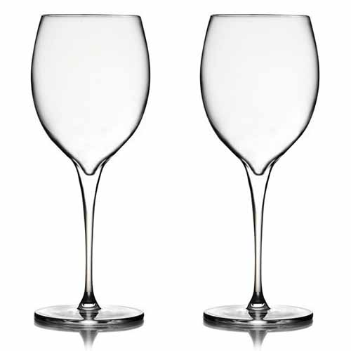 Two clear stemware glasses for red wine, isolated on a white background.