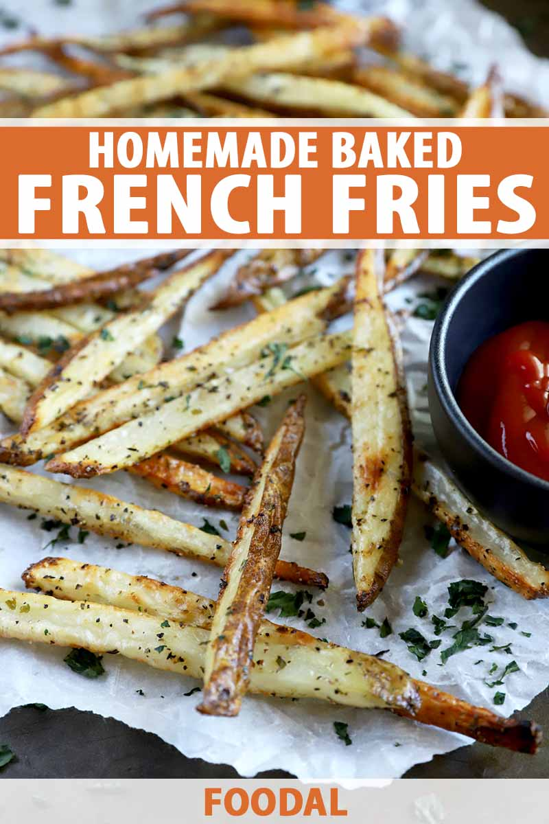 Vertical image of a parchment-covered baking sheet with seasoned french fries and ketchup, with text on the top and bottom of the image.