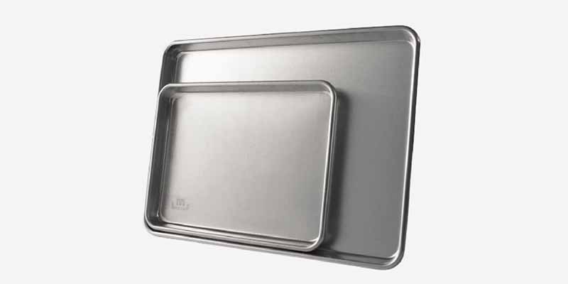 Horizontal image of two baking sheets in different sizes