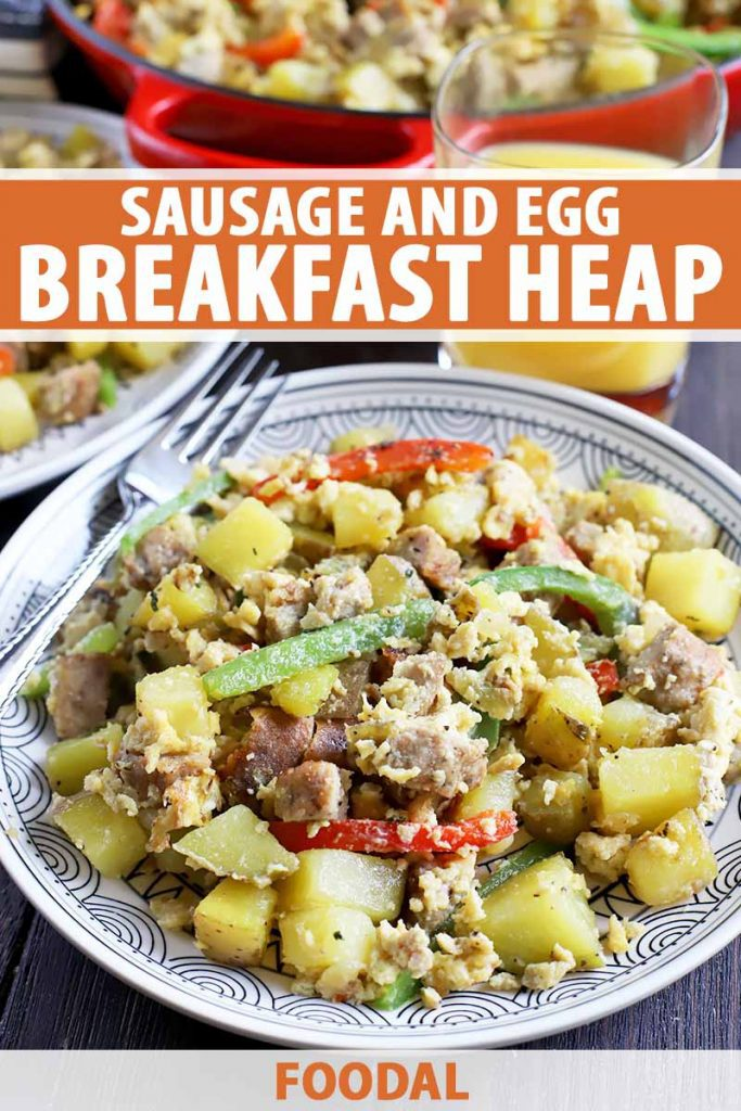 Vertical image of a white patterned plate with a scramble of egg, peppers, potatoes, and sausage, with text on the top and bottom of the image.