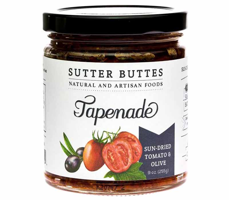 Image of a jar of Sutter Buttes tapenade with an image of tomatoes and olives on the front.