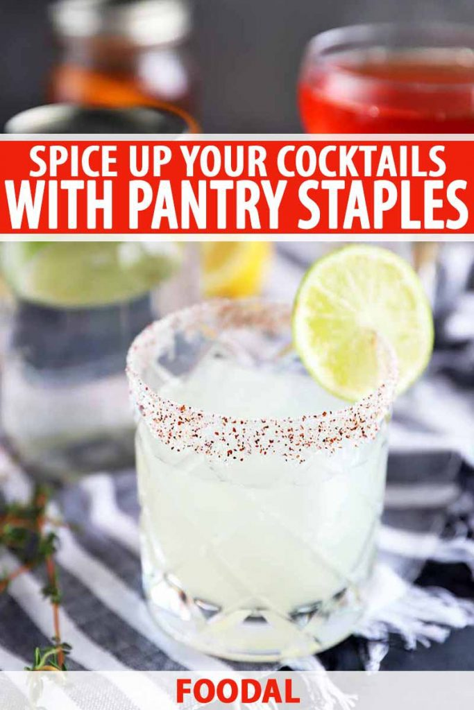 Vertical image of a tequila cocktail in a lowball glass, with a salt and chili pepper rim and garnished with a slice of lime, on a gray and white striped cloth with scattered fresh herbs, with jars and glasses of flavor-infused liquor in soft focus in the background, printed with red-orange and white text in the top third and at the bottom of the frame.