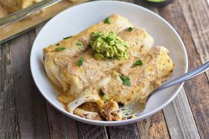 Chicken, Black Bean, and Red Pepper Enchiladas Smothered in Smoky Garlic Cream Sauce