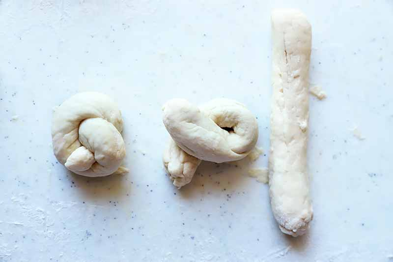 Horizontal image of three stages of forming a knot with pizza dough.