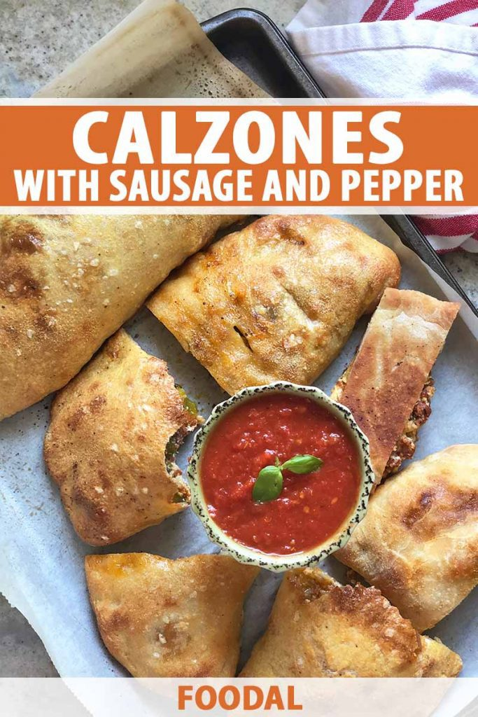 Vertical image of calzones cut in assorted sizes on a baking sheet with a bowl of marinara, with text on the top and bottom of the image.