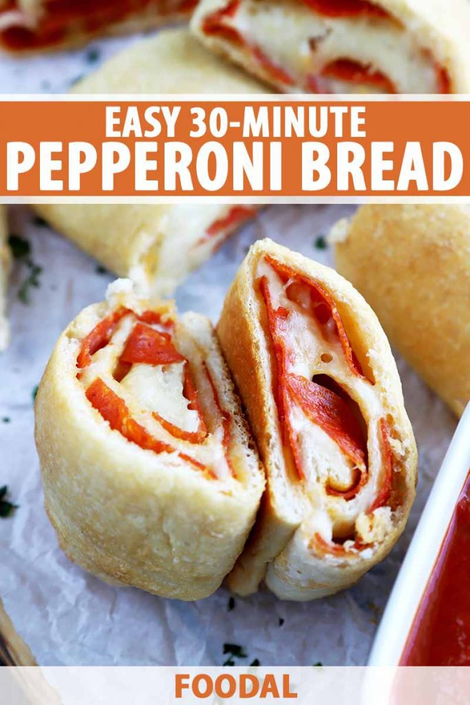 Vertical close-up image of two slices of pepperoni bread on parchment paper, with text on the top and bottom of the image.