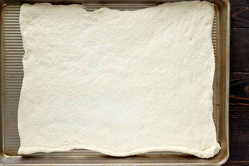 Horizontal image of a stretched out rectangular dough.