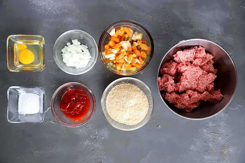 Horizontal image of bowls of ingredients to make meatloaf.