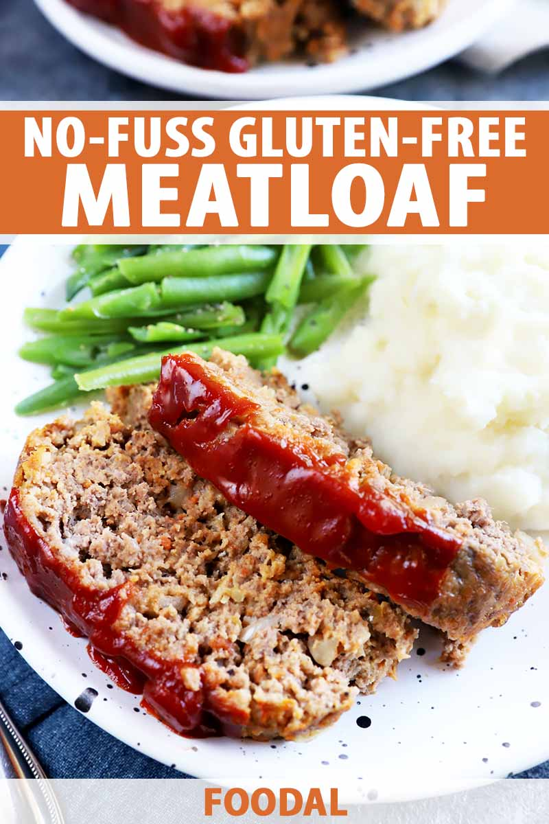 Vertical image of two slices of a meatloaf covered in a ketchup glaze on a plate with mashed potatoes and green beans, with text on the top and bottom of the image.