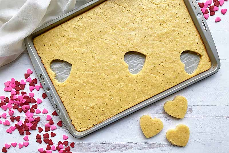 Horizontal image of a cutting out shapes in a dessert in a baking sheet.