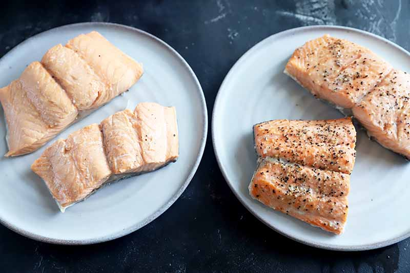Horizontal image of a plate of cooked unseasoned seafood fillets and a plate of seasoned cooked seafood fillets.