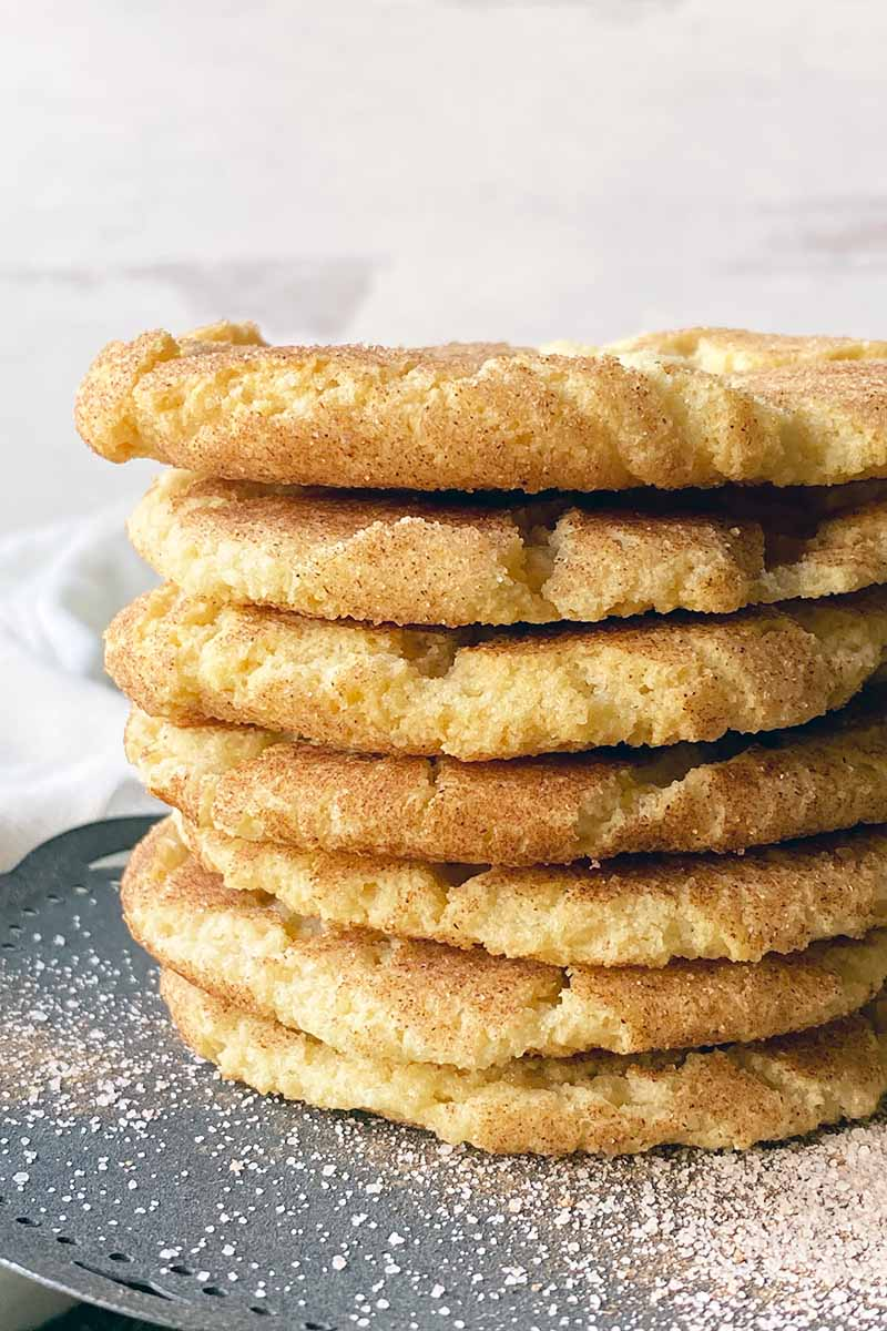 Vertical close-up image of a tall stack of cookies on a gray stand.