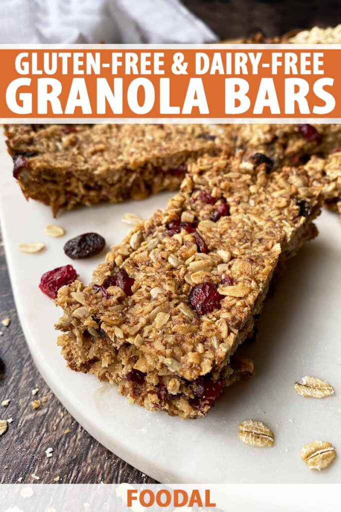 Vertical image of granola bars on a white surface with text on the top and bottom of the image.