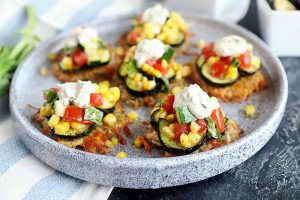 Potato Fritters with Roasted Zucchini and Tomato Cucumber Corn Salad are the Ideal Summer Appetizer