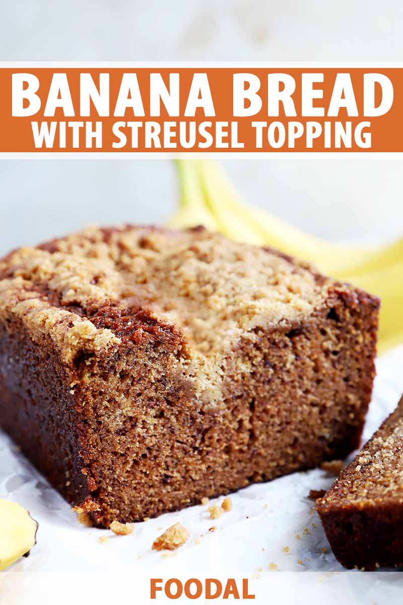 Vertical image of a halved baked loaf topped with a crumble, with text on the top and bottom of the image.