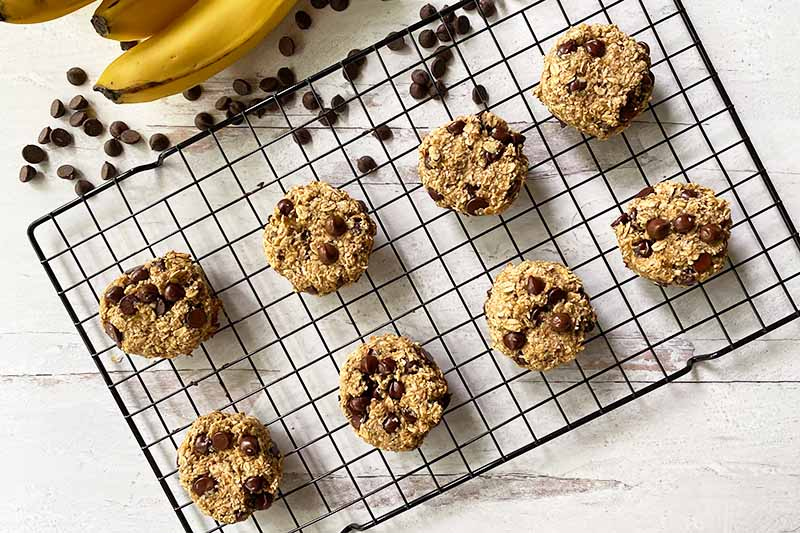 Horizontal image of baked cookies on a cooling rack.