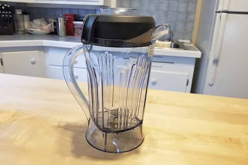 Horizontal image of a blender off the base on a countertop.