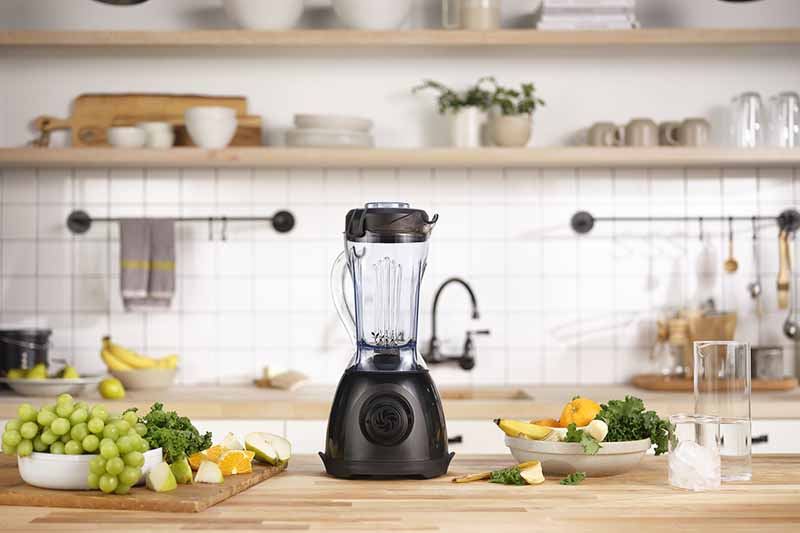 Horizontal image of a blender in a kitchen.