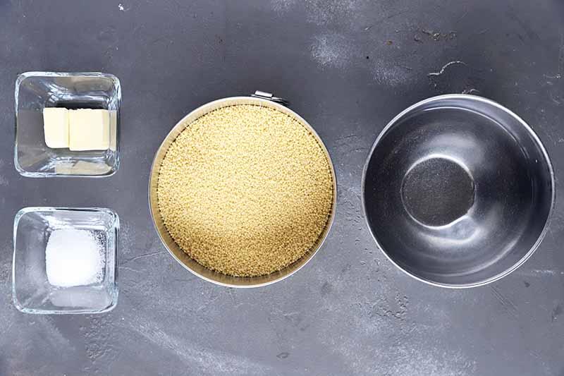 Horizontal image of bowls of seasonings, water, and grains.