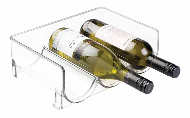 Horizontal image of a clear plastic bottle holder, with two wine bottles on it.
